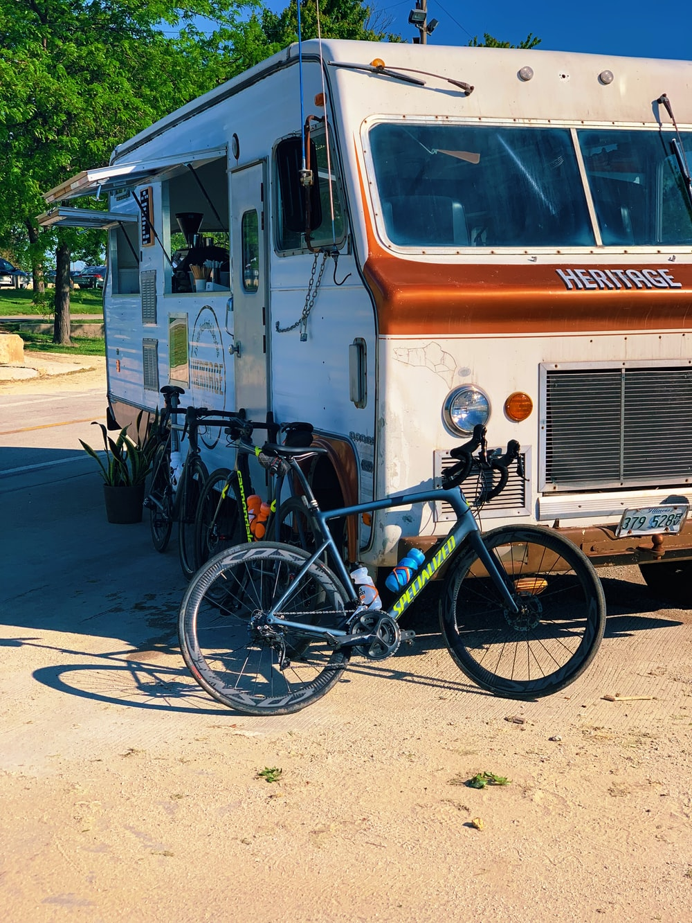 blue bike near RV trailer screenshot
