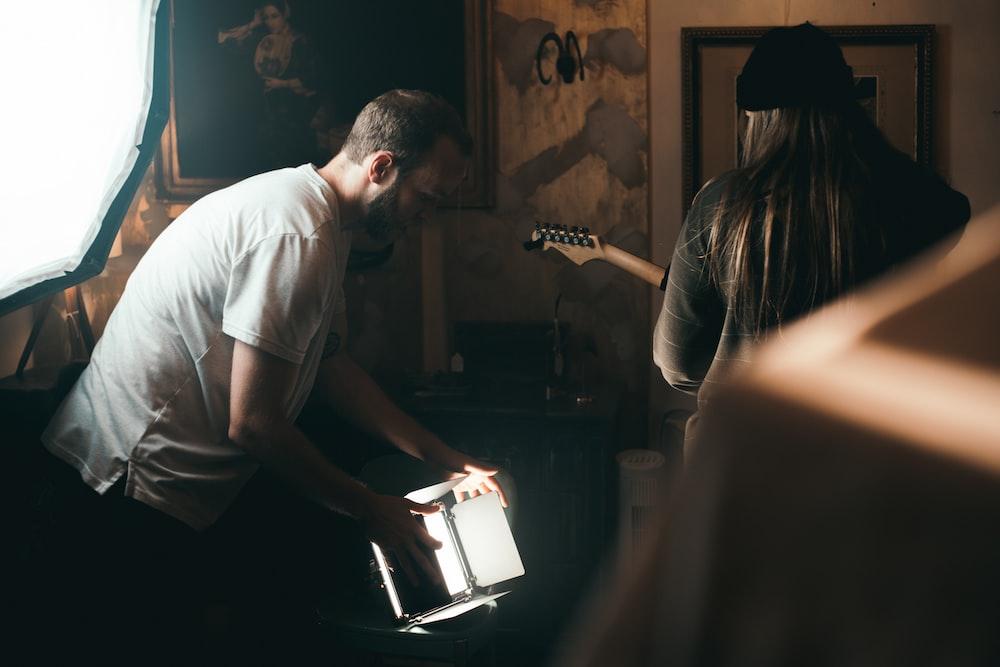 man holding music sheet