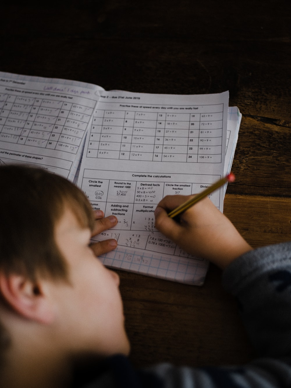 toddler writing indoors