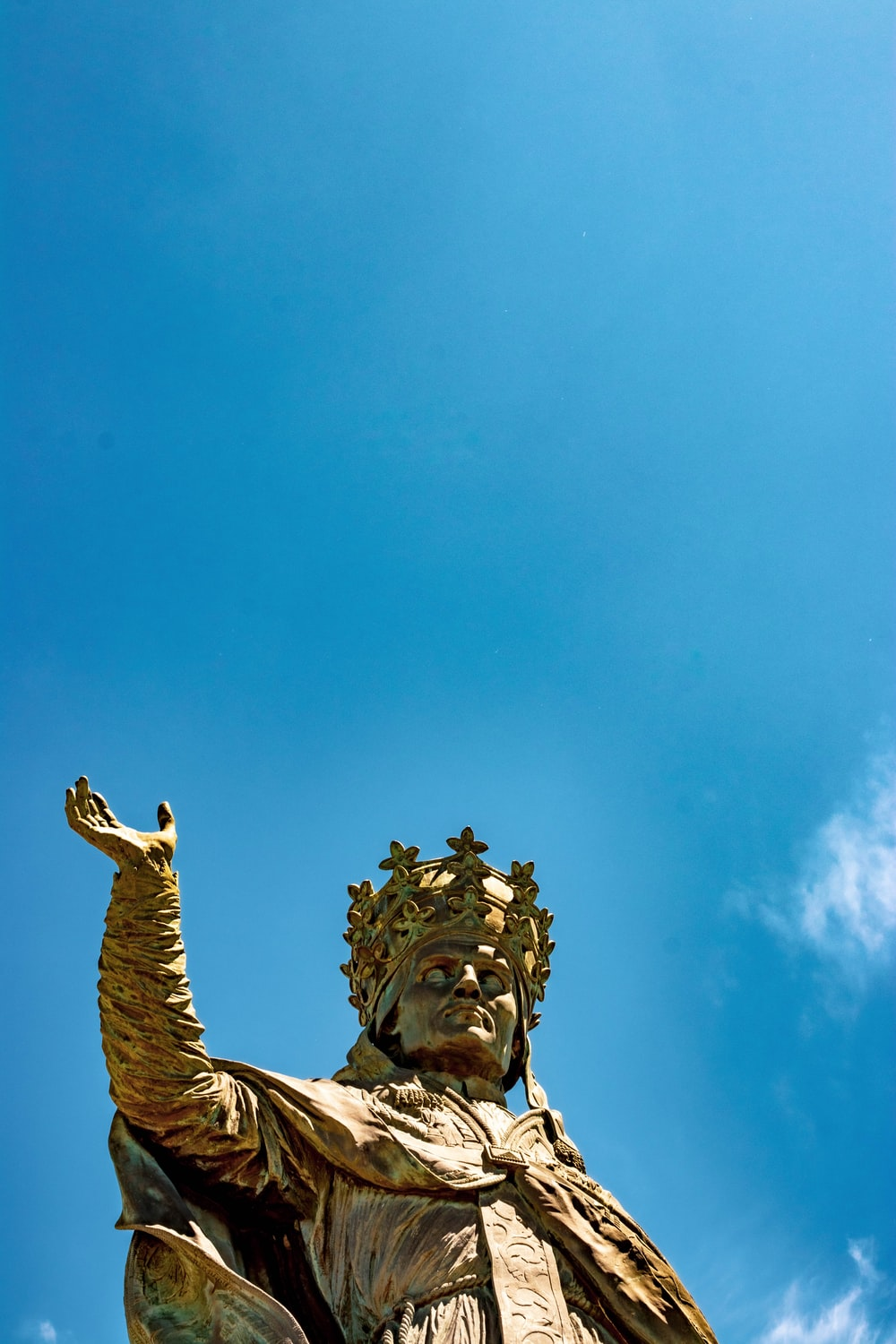 low angle view of king statue under clear blue sky