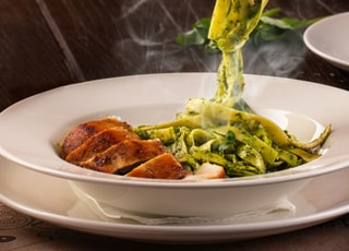 green pasta on white plate