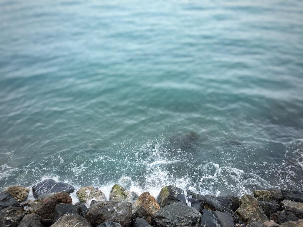 waves breaking in rocky beach