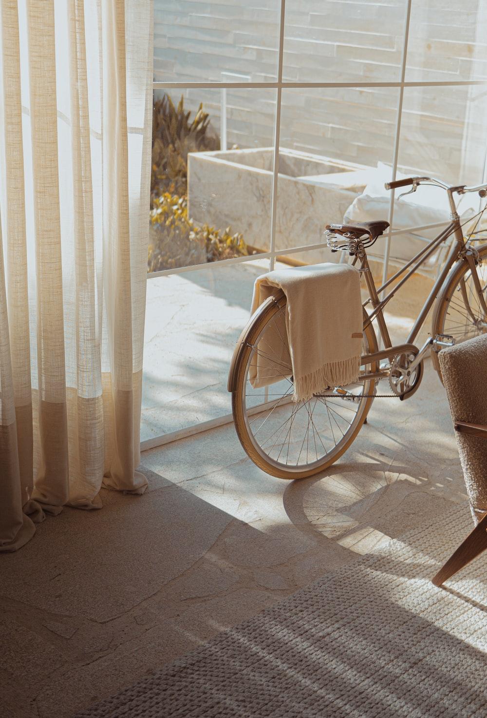 white bike near glass wall