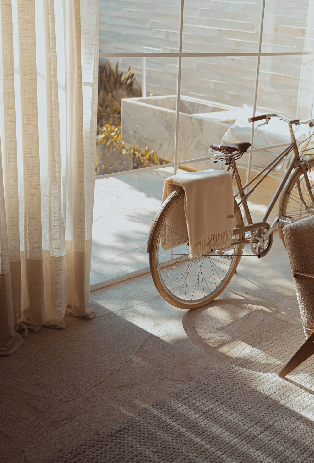 white bike near glass wall
