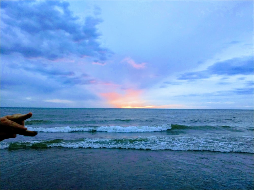 landscape photo of a beach at sunrise