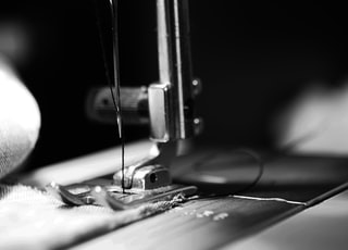 sewing machine grey-scale photography and close-up photography