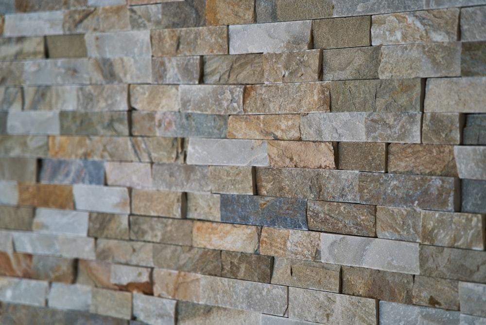 gray and brown bricked wall