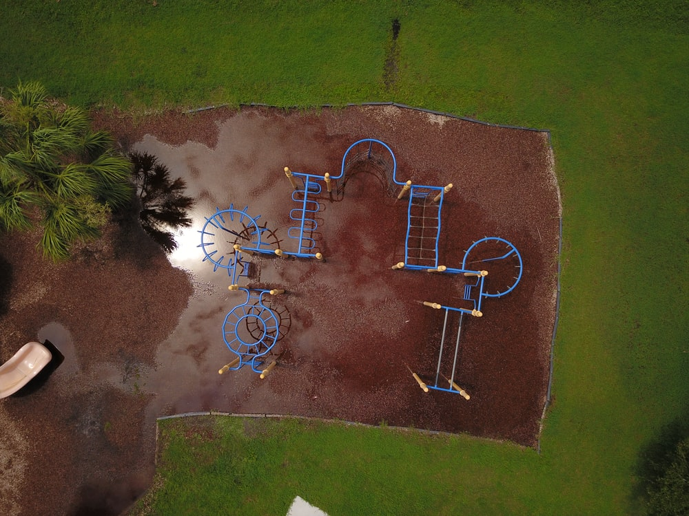 blue metal playground lot aerial view photography