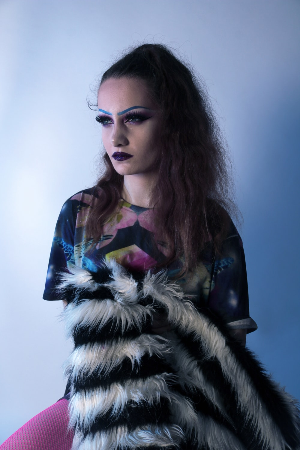 person wearing a fury dress in a room close-up photography