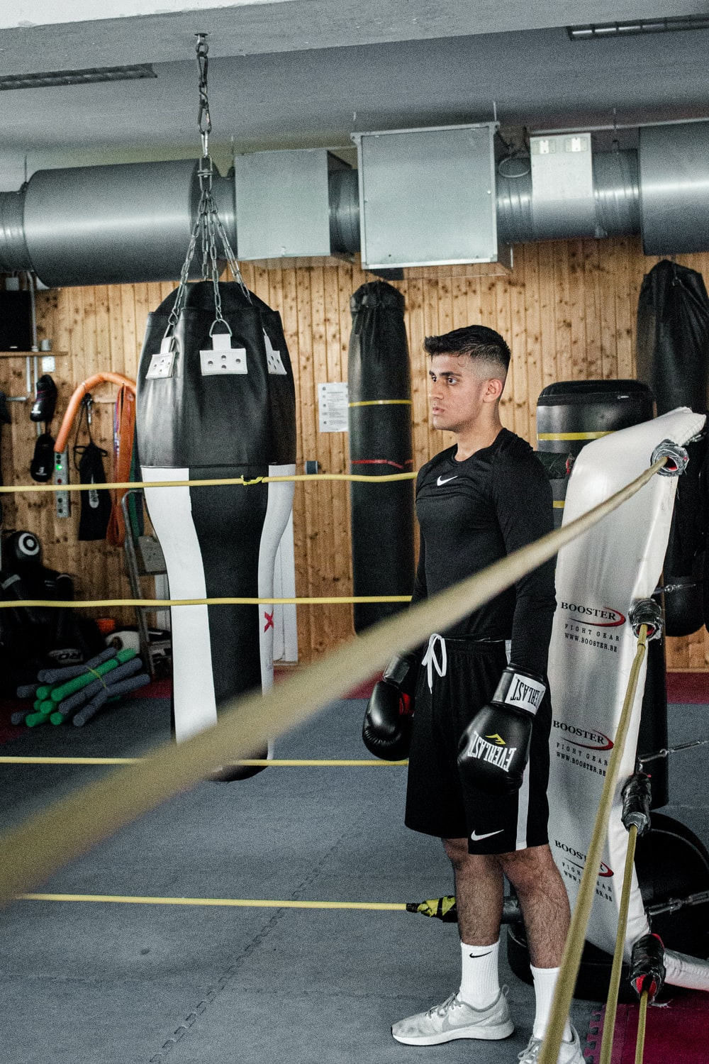 man standing at the corner of boxing ring