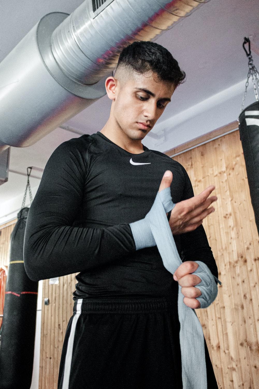 man bandaging his wrist