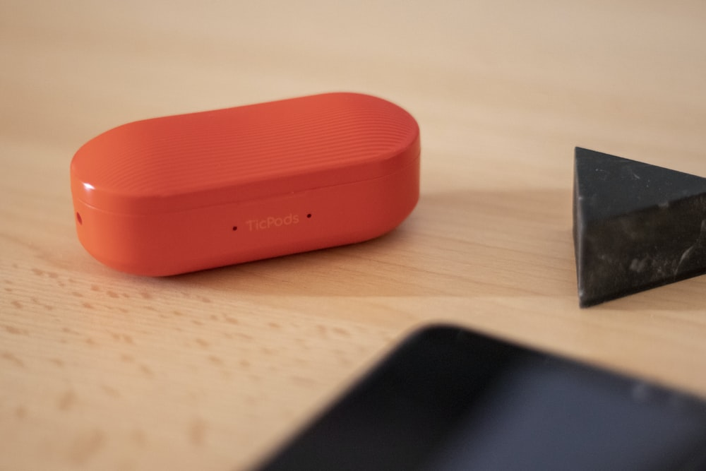 oval red speaker beside triangle stone