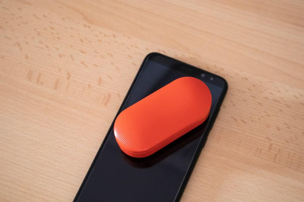 oval black case on black smartphone