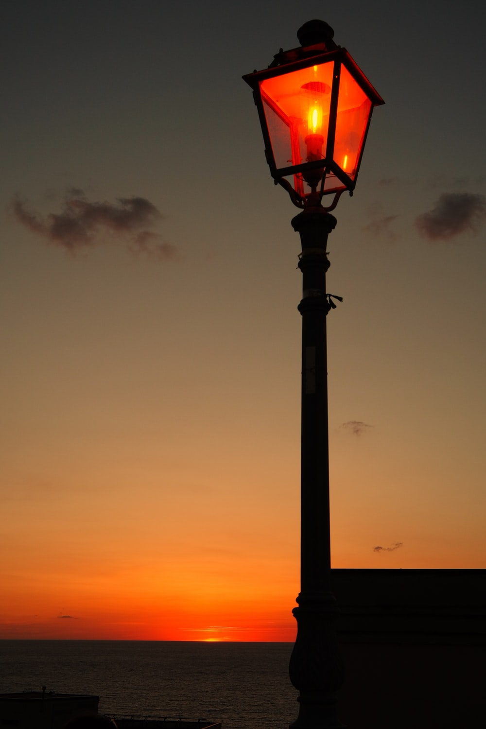 silhouette photography of street light