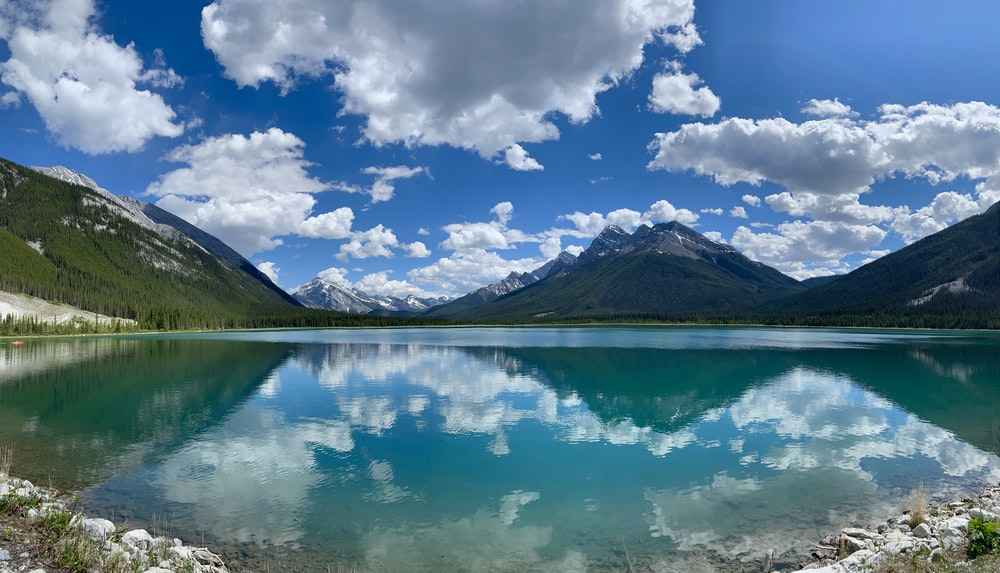 view of mountain lake with water reflection