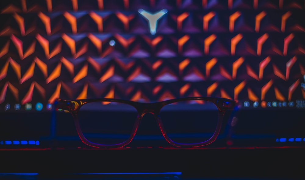 red framed eyeglasses in a room close-up photography