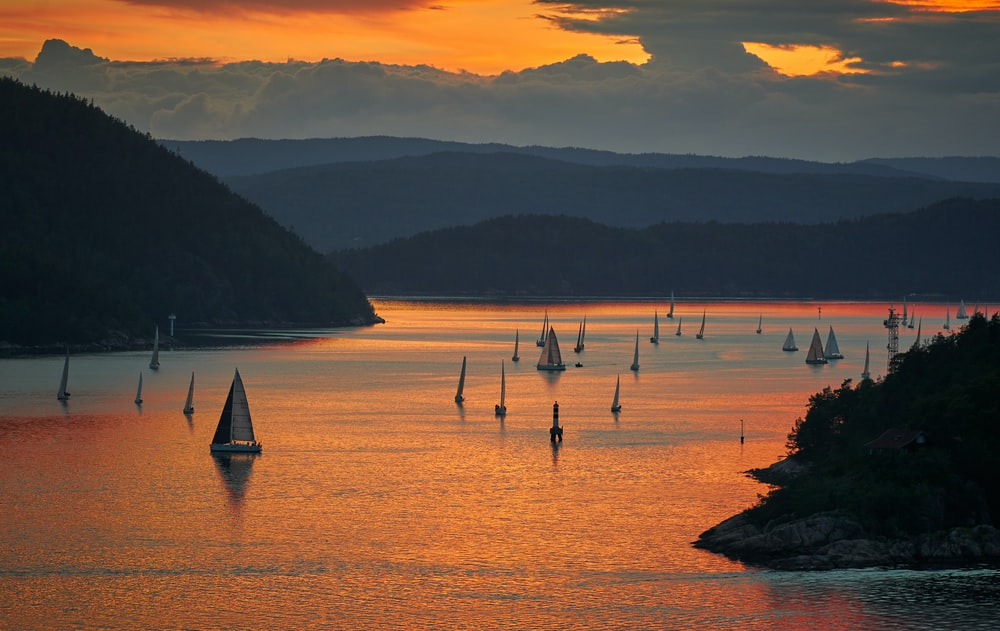 sail boats on body of water during daytie