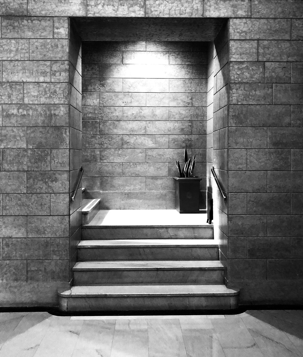 grayscale photo of concrete staire