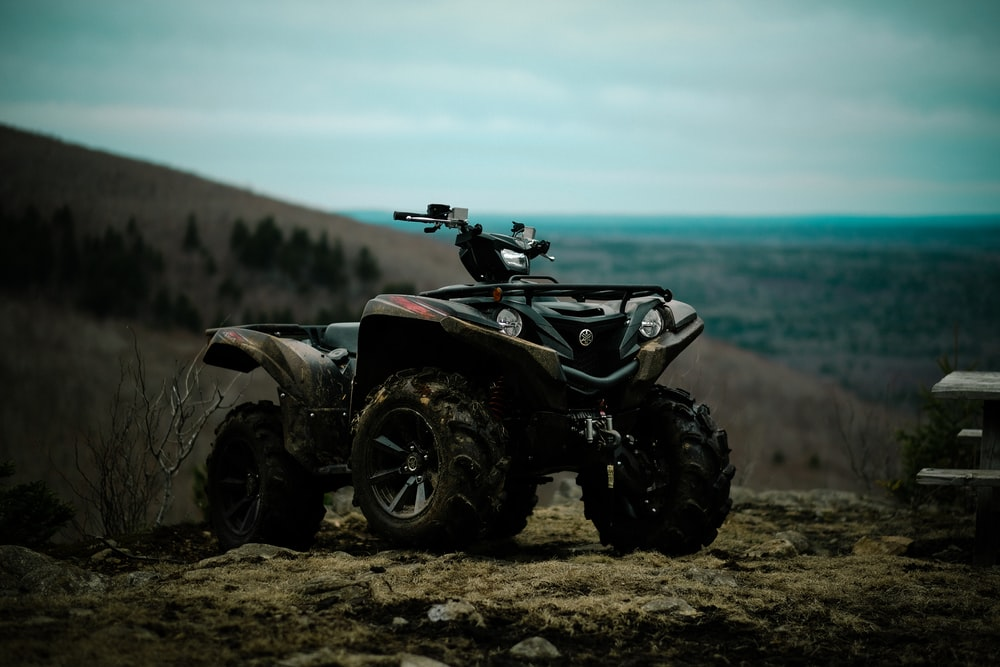 ATV parked on soil ground during day