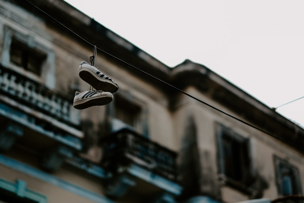 shoes hanging no rope