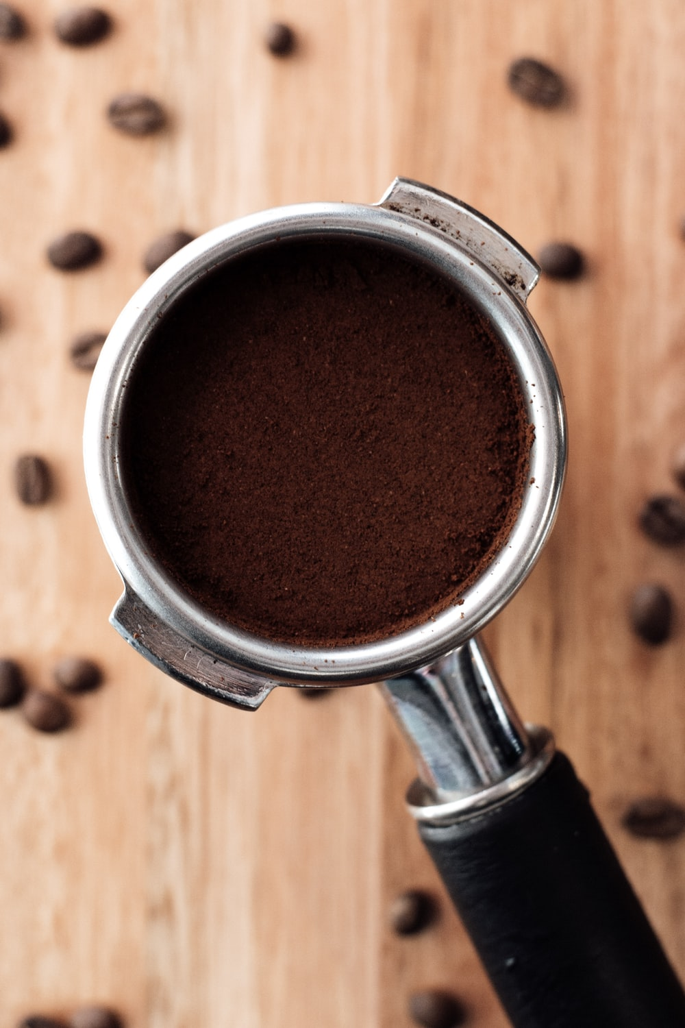 ground coffee on stainless steel cup