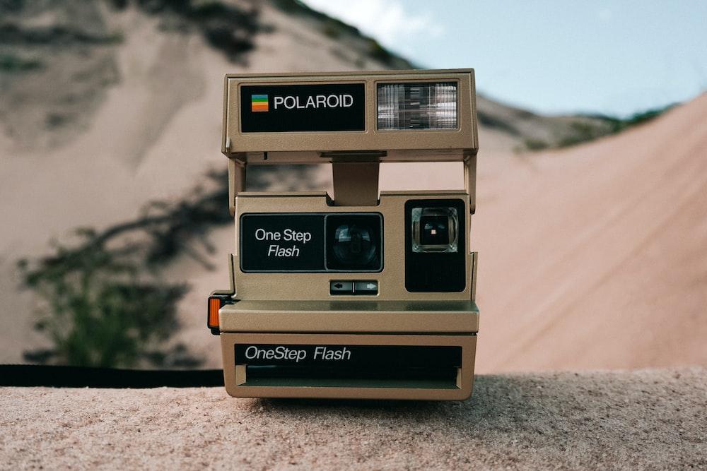 beige Polaroid instant camera