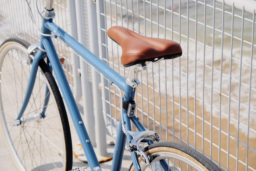 blue road bike beside handrail