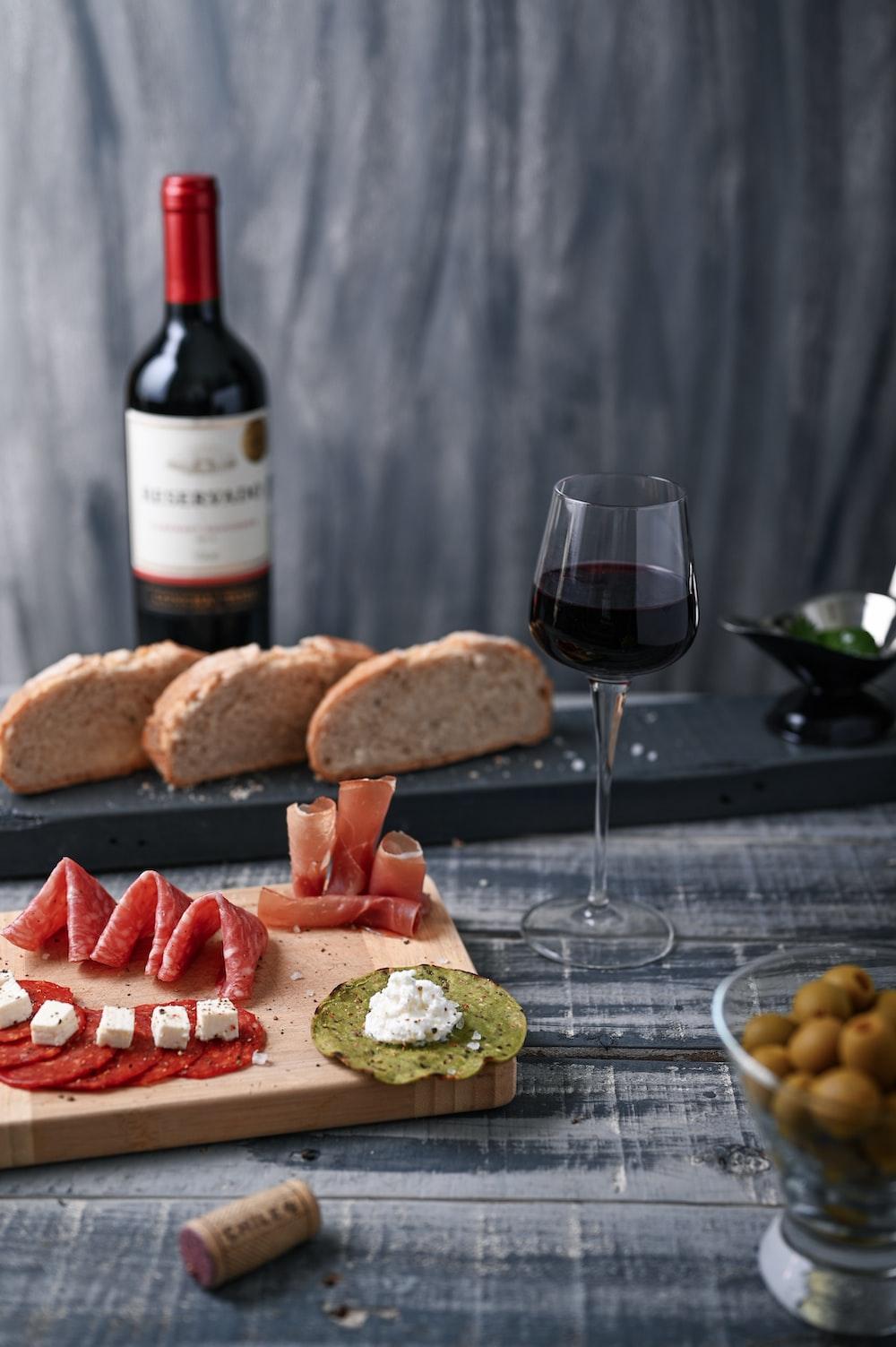 wine glass beside food on board