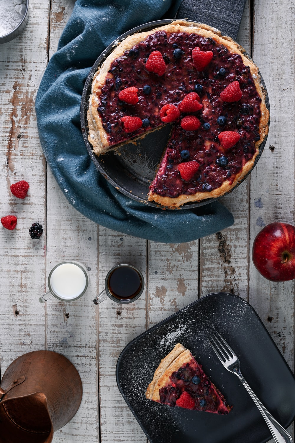 cooked pie with blueberries and strawberries