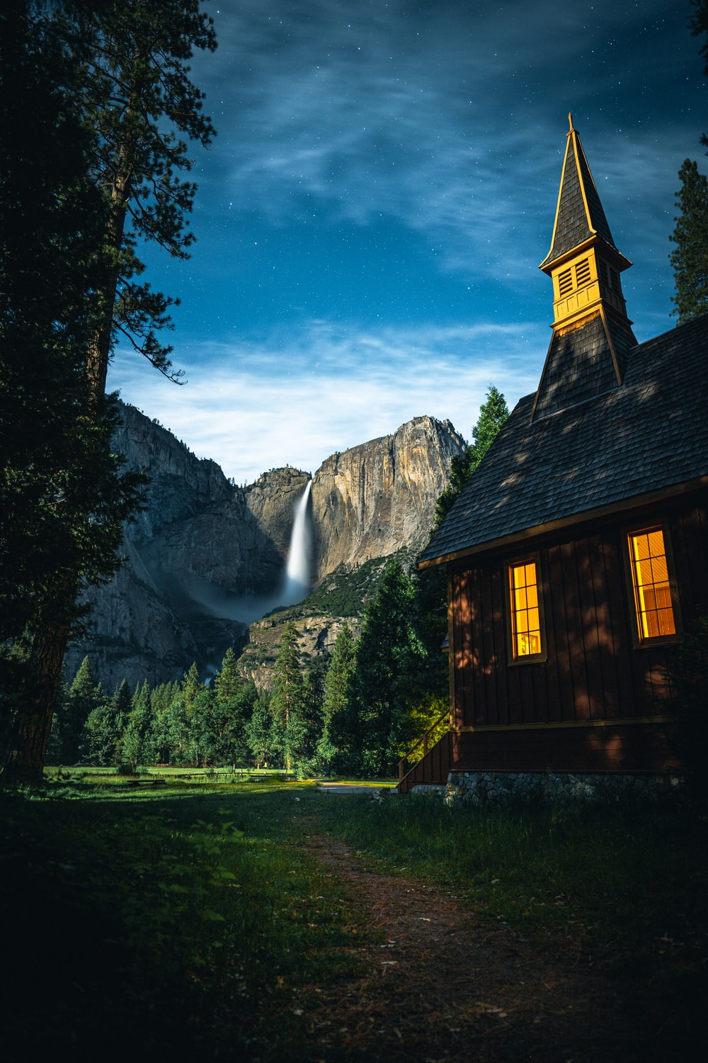 church near trees and waterfalls during day