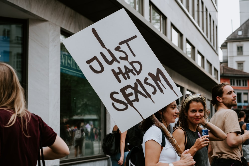 woman holding I just had sexism sign
