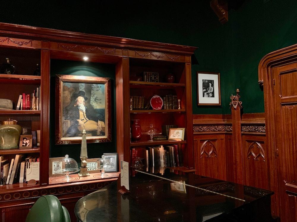 black wooden grand piano inside room