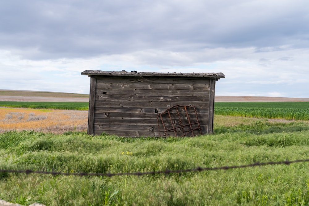 brown wooden tool shed
