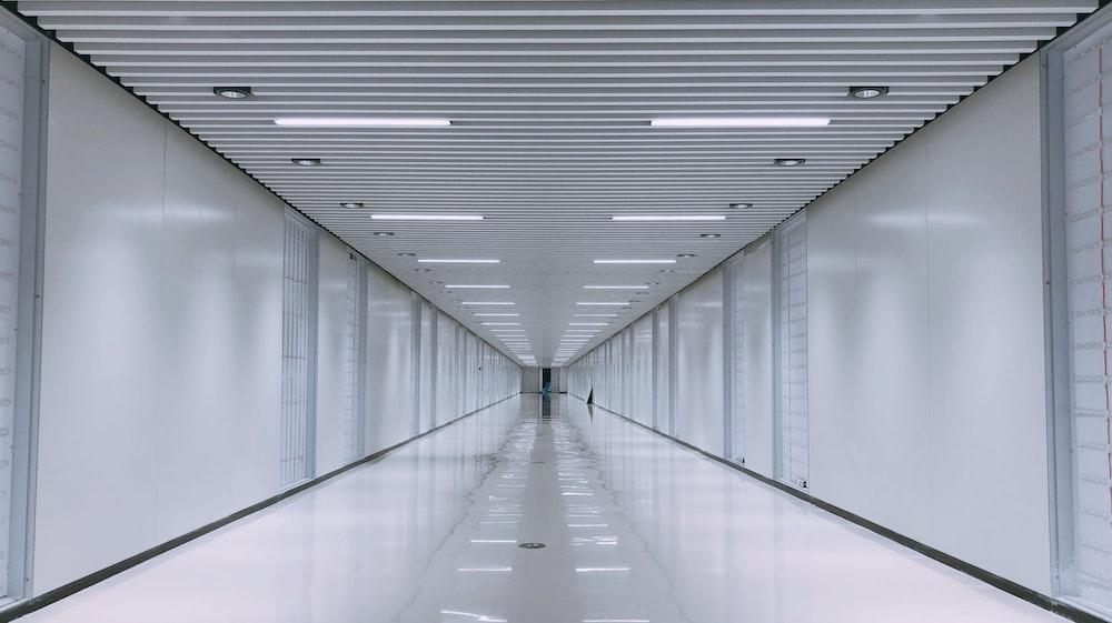 white concrete hallway