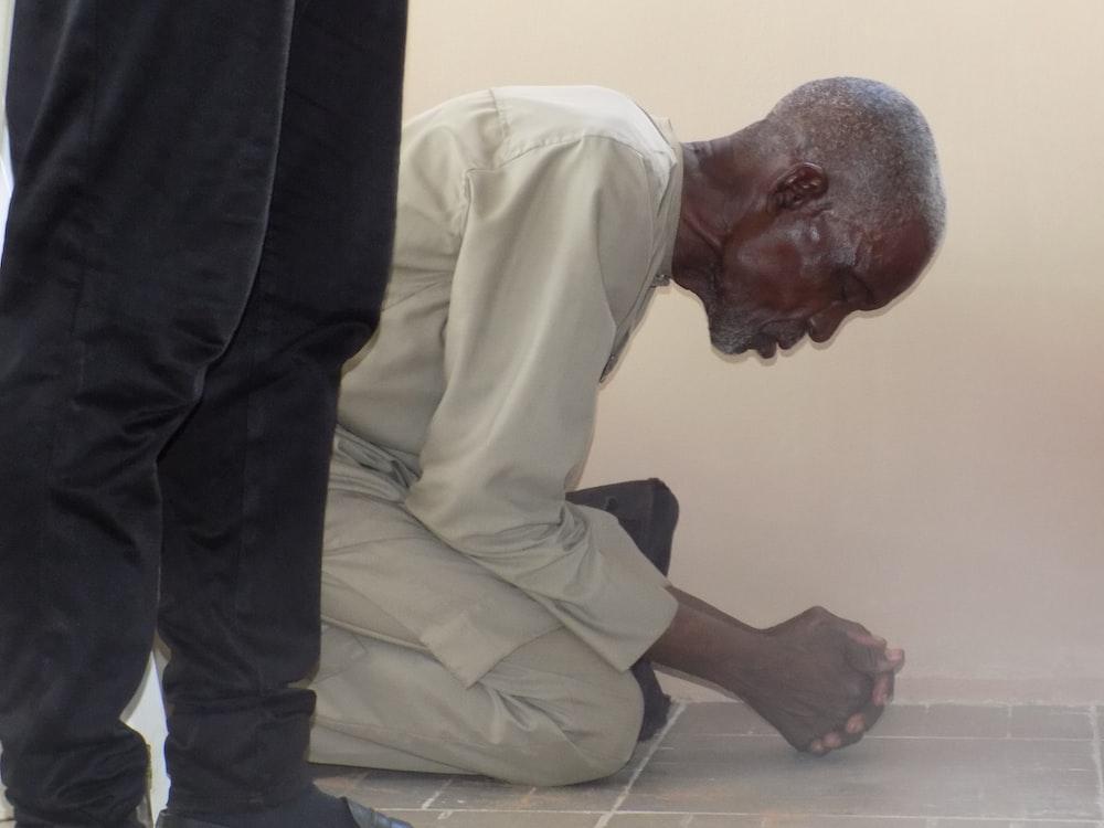 man kneeling and praying