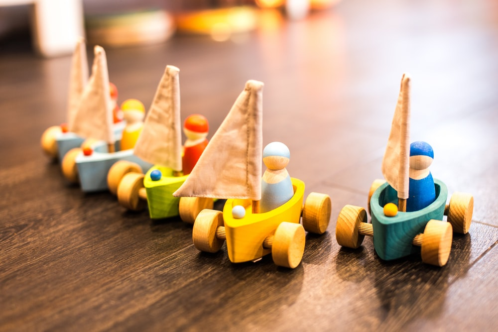 five assorted-color racing car toys
