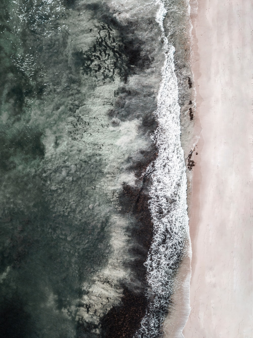 aerial view of crashing waves