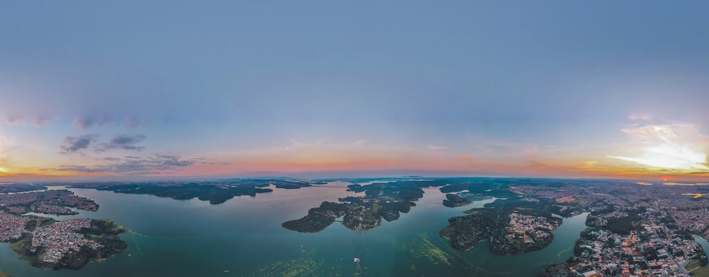 aerial photography of city buildings and body of water\