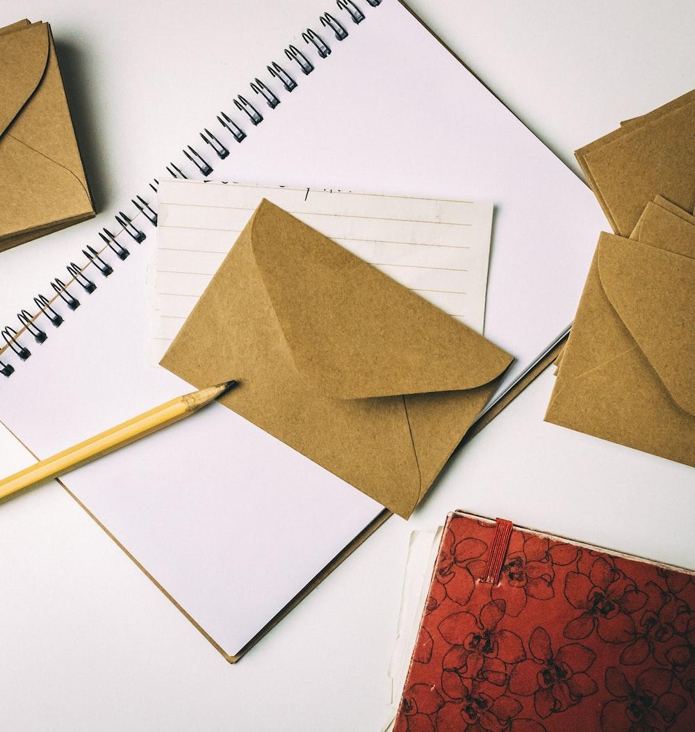 brown envelope on notebook