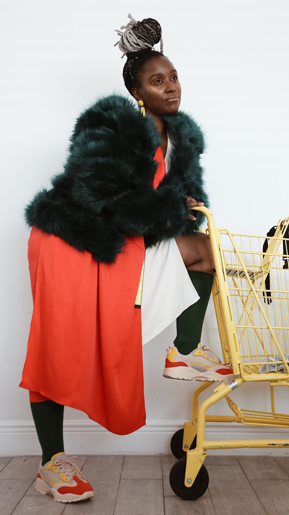 woman leaning on yellow grocery cart