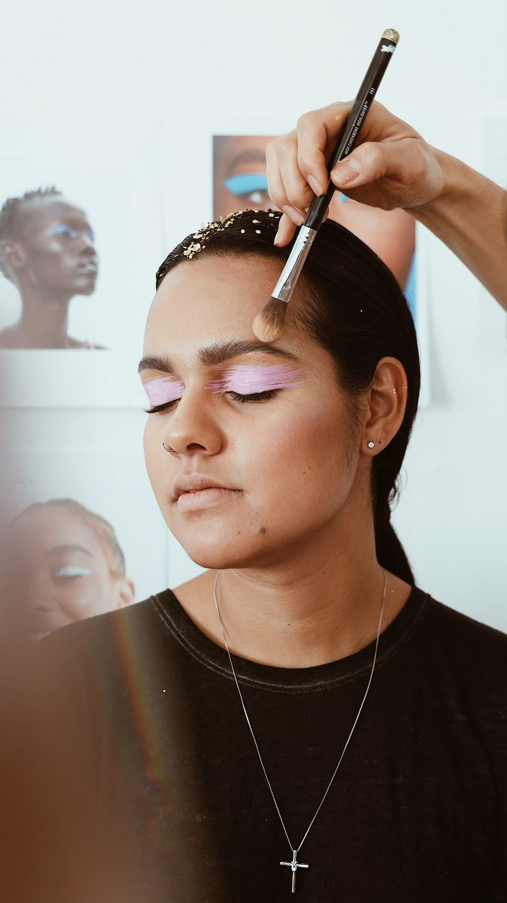 woman receiving makeup application on her forehead
