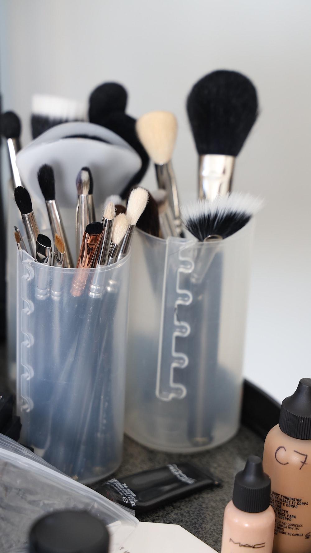 make-up brushes on white plastic organizers