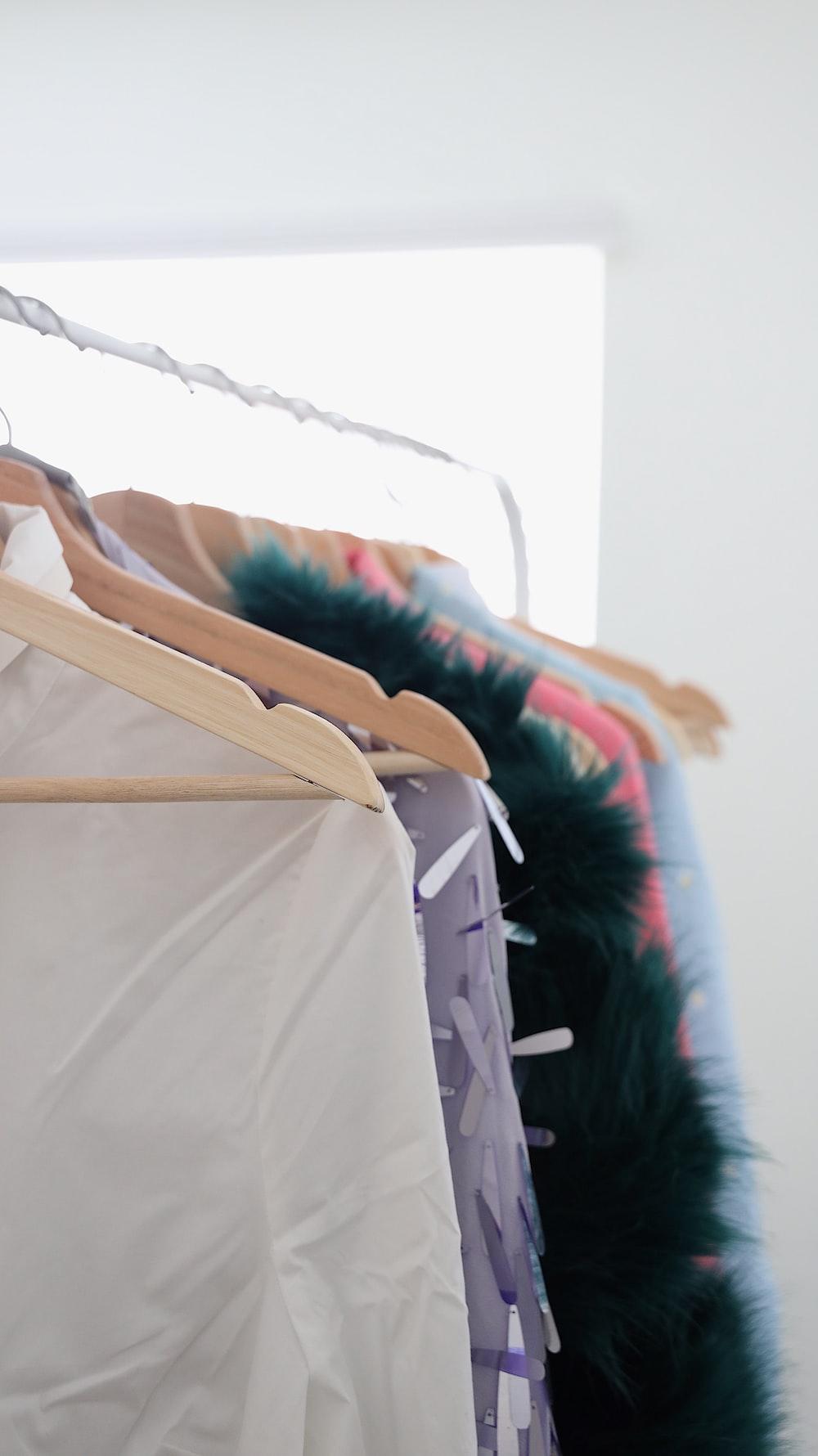 assorted garments hanging on rack