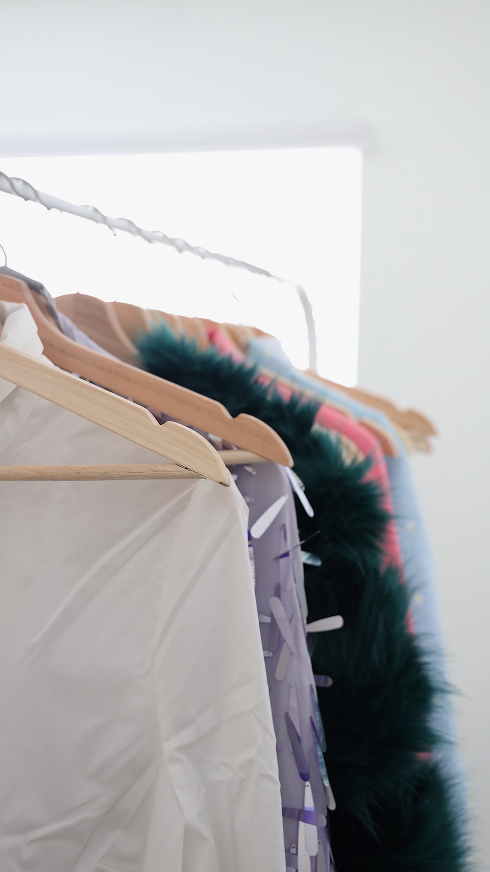 assorted garments hanging on rack