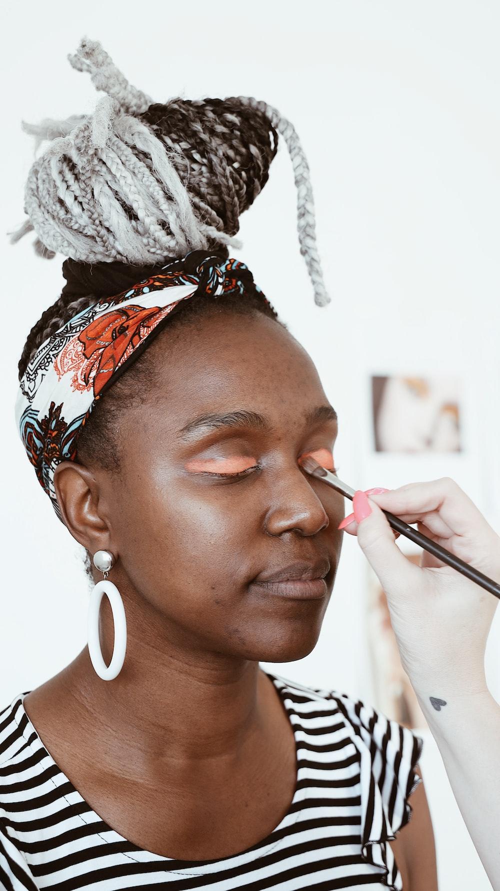 woman receiving makeup