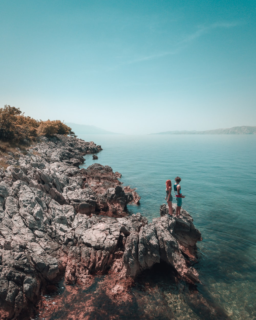 man and woman on rock