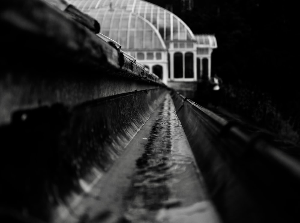 grayscale and close-up photography of train rail