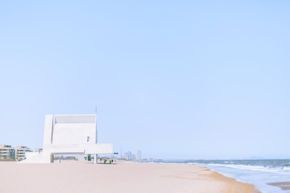 white building by the sea