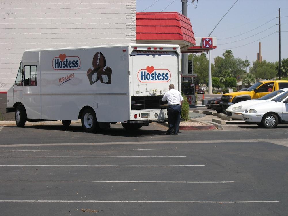 white Hostes truck on road