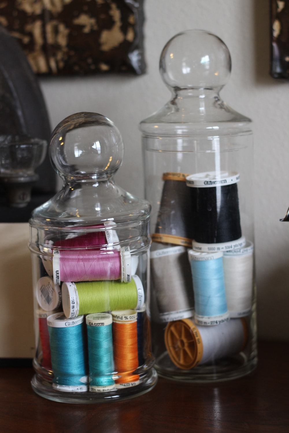 two clear glass jars with threads